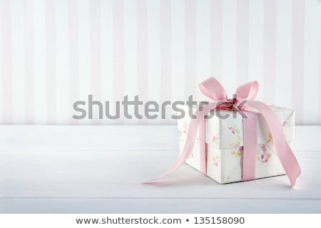pink ribbons and a bow on a white wooden background stock photo © zerbor