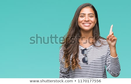 beautiful girl showing number one with fingers of one hand stock photo © giulio_fornasar