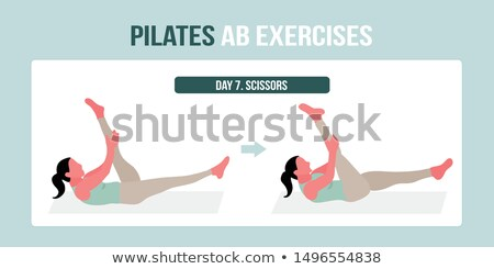 Pilates woman scissor exercise workout at gym Stock photo © lunamarina