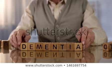 Health word on puzzle in man hands Stock photo © fuzzbones0