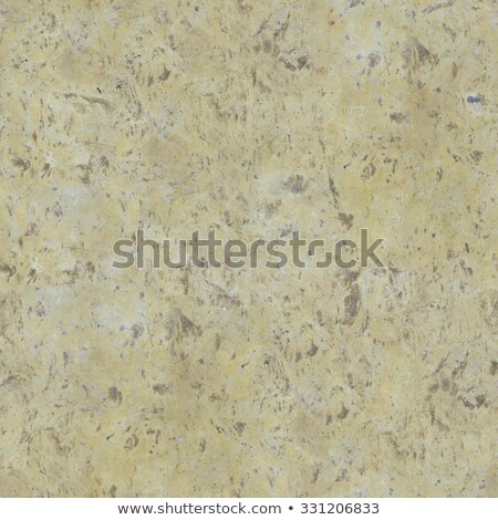 yellow ancient sandstone with brown blotches stock photo © tashatuvango