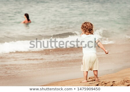 Happy family with little girl bathe in sea, standing back stock photo © Paha_L
