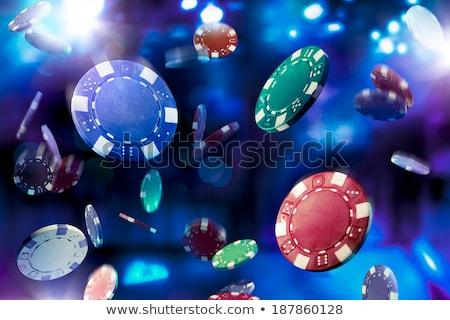 Hazárdjáték kaszinó zsetonok zuhan póker zsetonok zöld kék Stock fotó © Winner