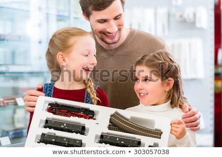 man in toy store buying model railroad stock photo © kzenon