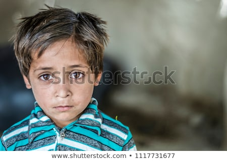 portrait of poverty little poor dirty boy closeup stock photo © zurijeta