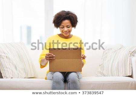 feliz · África · paquete · cuadro · casa - foto stock © dolgachov