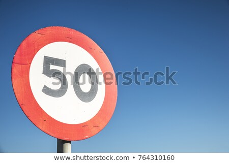 Stok fotoğraf: 50 Kmph Or Mph Driving Speed Limit Sign On Highway