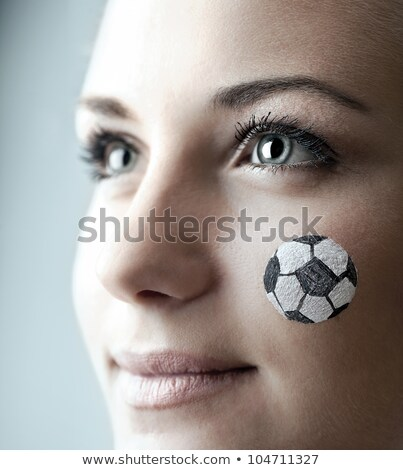 side view portrait of a sport woman with soccer ball stock photo © deandrobot