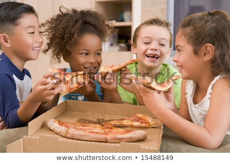 Group Of Children Eating Pizza At Home Stock photo © monkey_business