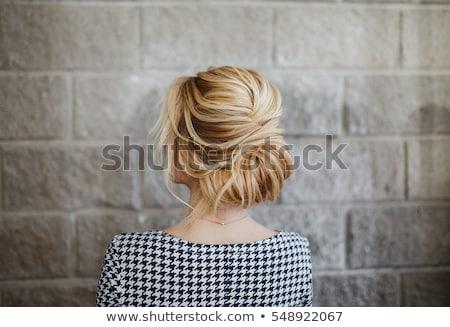 Portrait of a cute, delicate woman with colorful coiffure Stock photo © konradbak