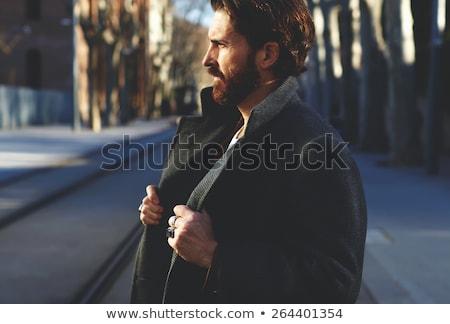 Hombre abrigo calle sonriendo pie Foto stock © deandrobot