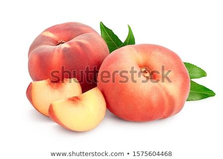 Peach, saturn or donut peaches with leaves Stock photo © yelenayemchuk