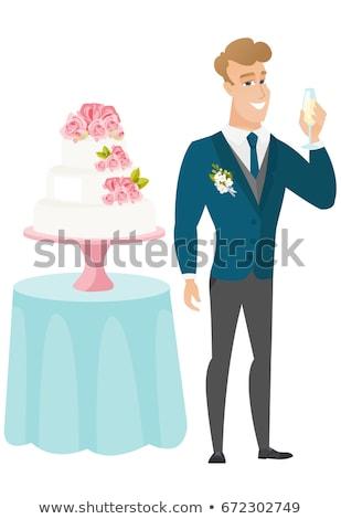 Groom standing near cake with glass of champagne. Stock photo © RAStudio