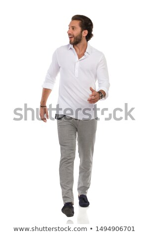 happy young man walking towards the camera stock photo © feedough