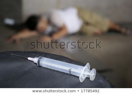 Drogas adicto piso jeringa primer plano Foto stock © palangsi