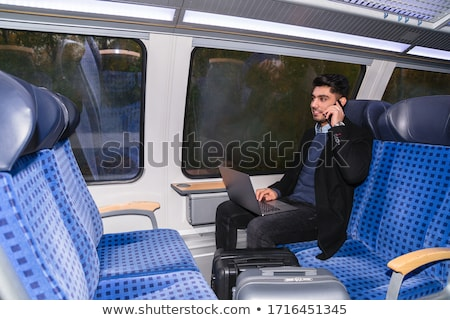 Arabic man with smartphone and suitcase Stock photo © studioworkstock