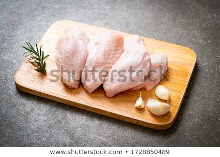 Surowy kurczaka skrzydełka deska do krojenia Zdjęcia stock © Digifoodstock