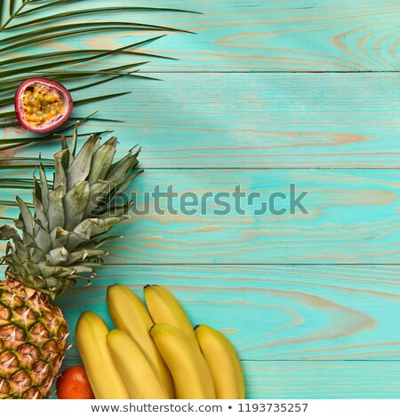 Sarok keret különböző trópusi gyümölcsök pálmalevél Stock fotó © artjazz