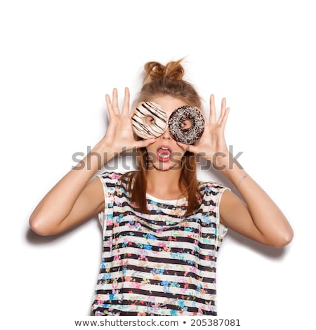 Portrait of a playful young woman showing pastry Stock photo © deandrobot