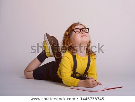 cute · colegiala · deberes · pequeño · piso - foto stock © dolgachov