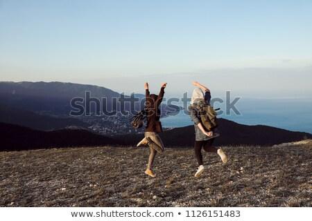 Iki kişi bakıyor gün batımı üst kış dağ Stok fotoğraf © vapi
