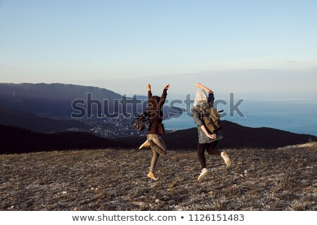 mensen · naar · zonsondergang · winter · bergen · gedekt - stockfoto © vapi