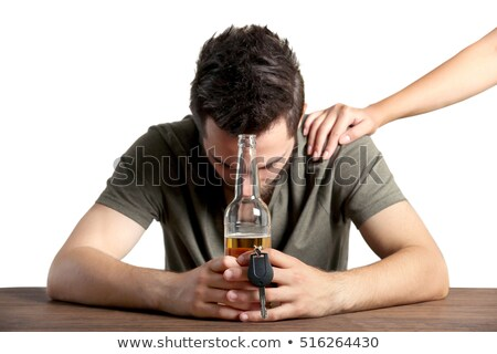 male hand with beer bottle and car key on table Stock photo © dolgachov
