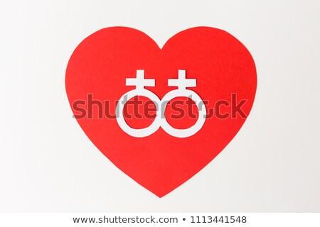 venus symbol on red heart over white background Stock photo © dolgachov