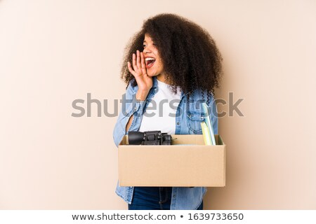Image of young woman 20s with curly hair shouting or calling, is Stock photo © deandrobot