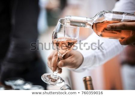 Gül şarap kadehi taş arka plan uzay şarap Stok fotoğraf © karandaev