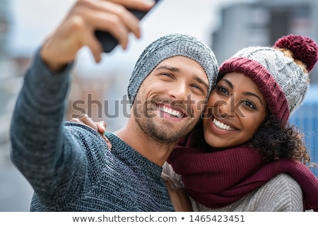 photo of cheerful african american guy and girl smiling and doin stock photo © deandrobot