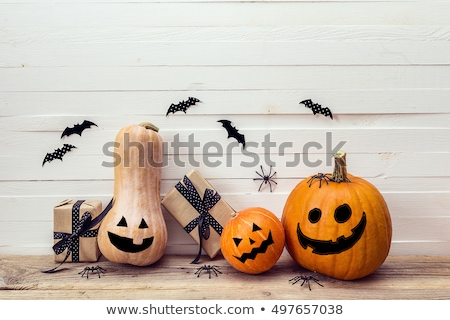 halloween decorations with space on wooden boards stock photo © dolgachov