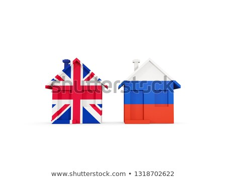 Two houses with flags of United Kingdom and russia Stock photo © MikhailMishchenko