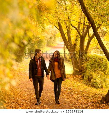 Smiling Man and Woman Happy Couple on Green Leaves Stock photo © robuart