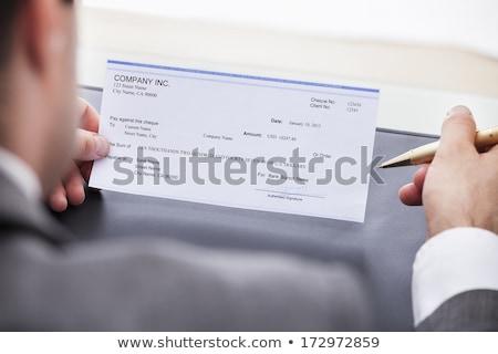 Affaires remplissage chèque bureau stylo Photo stock © AndreyPopov