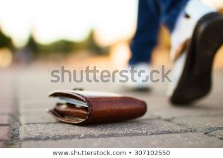 Elveszett pénztárca utca nő sétál pénz Stock fotó © AndreyPopov