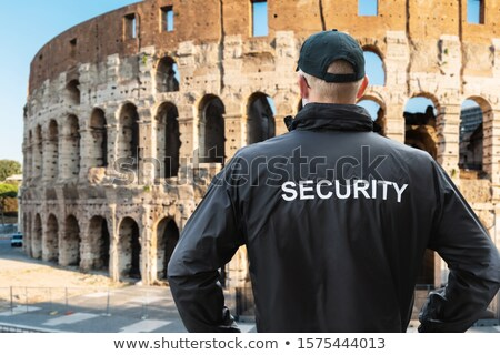 Man In Security Uniform Standing Near Coliseum In Rome Stock photo © AndreyPopov
