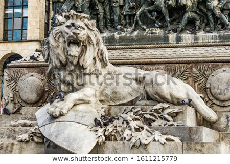 Lion on the pedestal of the monument to Victor Emmanuel II in Mi Stock photo © boggy