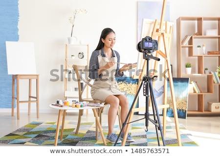 asian female blogger with camera recording video Stock photo © dolgachov
