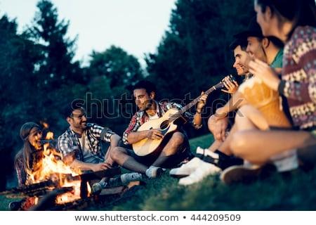 Gitar kamp ateşi fotoğraf adam oynama Stok fotoğraf © olira