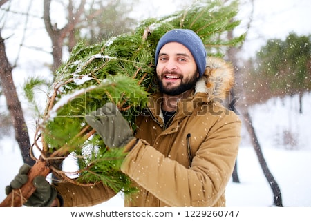 Lumberjack in the woods with an ax Stock photo © olira