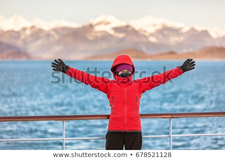 ストックフォト: Alaska Glacier Bay Cruise Travel Fun Tourist Excited Looking At Inside Passage Happy Woman With Ope