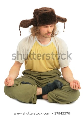 meditating long-haired Russian man in cap with ear-flaps Stock photo © Paha_L