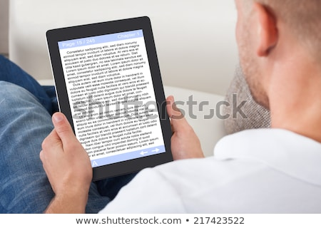 Holding Portable E-Book Reader stock photo © bloomua