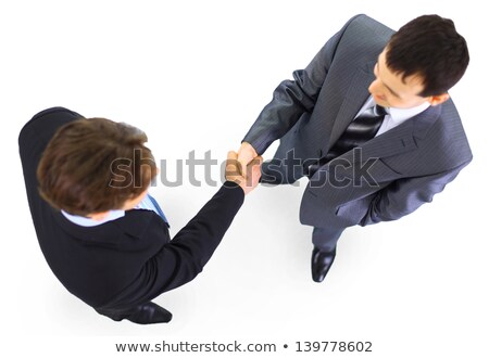 3d business people shaking hands over a deal stock photo © dacasdo