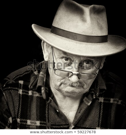 Photo portrait of senior male wearing a cowboy hat stock photo © stockyimages