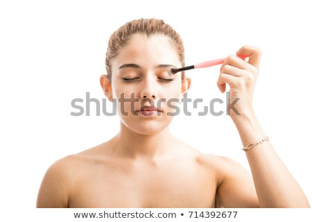 beautiful woman putting some eye shadow stock photo © photography33