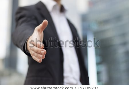 young businessman giving a hand for handshake stock photo © photography33