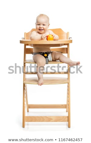 young child eating peaches in high chair Stock photo © gewoldi