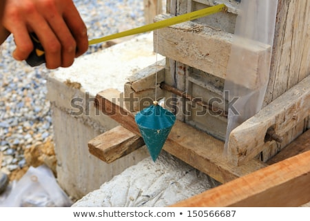 Mason checking a wall with a plumb bob. Stock photo © photography33